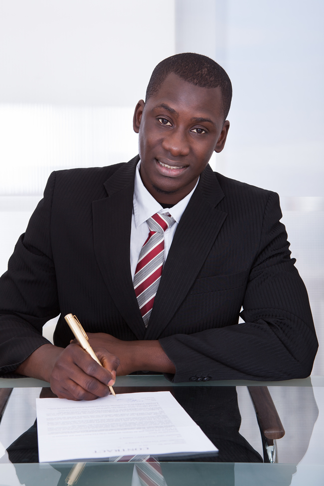 Businessman-signing-Contract